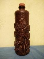 Декоративная бутылка ручной работы в технике плетения жгутом