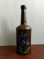 Декоративная бутылка ручной работы в технике плетения жгутом. Бутылка раскрашена акриловыми красками и покрыта акриловым лаком. Может использоваться по назначению. Также станет замечательным и оригинальным подарком друзьям и близким
