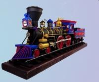 Американський поїзд другої половини 19сторіччя Central Pacific №60 JUPITER виконаний у маштабі 1:25. Модель виготовлена з картону різної товщини і вручу розфарбована акриловими фарбами. Модель складається з 2100 деталей вирізаних вручну,склеїних і змонтованих згідно креслення. Це точна копія поїзда, котрі випускались у Штатах з 1885 року. Розмір моделі: Довжина 46см.,ширина- 8 см, висота - 17см.