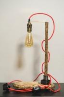 """Настільна лампа """"Pride&Joy"""", виготовлена з натурального дерева і авто-деталей з лампою Едісона. Ручна робота з індивідуальним дизайном. Встановлено димер для регулювання яскравості світла на будь-який смак.  особливості: - З унікальних автодеталей і натурального дерева; - Встановлено димер; - Довжина - 150 см .; - Стандартний патрон; - Лампа Едісона входить в комплект;  Основа: 230 cm x 15 cm x 2,5 cm Висота: 48 cm Кабель: 150 cm Вага: 2 kg  Дану модель можна виготовити під замовлення в необхідній кількості. Авто-деталі можуть трохи відрізнятися від заявлених на фото."""