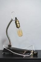 """На замовлення. Термін виготовлення: 5-7 робочих днів (підставка може трохи різнитися, від заявленної на фото, залежить від наявної деревини)  Настільна лампа """"Pride&Joy"""", виготовлена з авто-деталей, стали і натурального дерева з лампою Едісона. Ручна робота з індивідуальним дизайном. Встановлено димер для регулювання яскравості світла на будь-який смак.  особливості: - З унікальних автодеталей і натурального дерева; - Встановлено димер; - Стандартний патрон; - Лампа Едісона входить в комплект;  Основа: 25 cm x 14 cm x 3 cm Висота: 35 cm Вага: 2 kg  Дану модель можна виготовити під замовлення в необхідній кількості. Авто-деталі і шия можуть трохи відрізнятися від заявлених на фото.  Кінцева обробка дерев"""