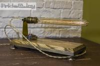 """На замовлення. Термін виготовлення: 5-7 робочих днів.  Настільна лампа """"Pride&Joy"""", виготовлена з авто-деталей, металу та натурального дерева, з лампою Едісона. Ручна робота з індивідуальним дизайном. Встановлено димер для регулювання яскравості світла, на будь-який смак.  особливості: - З унікальних автодеталей і натурального дерева; - Встановлено диммер; - Довжина шнура - 150 см .; - Стандартний патрон; - Лампа Едісона входить в комплект;  Основа: 30 cm x 15 cm x 3 cm Висота: 15 cm Вага: 2 kg  Дану модель можна виготовити під замовлення в необхідній кількості. Авто-деталі можуть трохи відрізняться від заявлених на фото"""