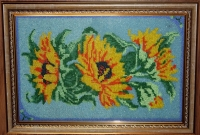 Ручна робота, виготовлена в техніці вишивка бісером. Розміри: 29х41 см. Кількість кольорів – 11. Вишивка оформлена в раму зі склом.